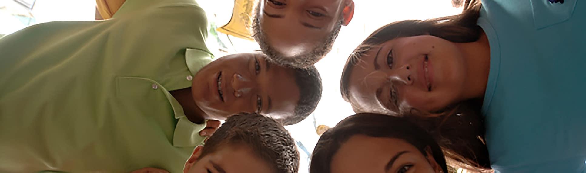 Smiling children in a huddle