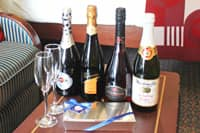Bon Voyage  - An opulent selection of Champagne and praline-mix chocolates. Martinelli's Sparkling Cider is also available.
