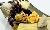 Fruit and Cheese Platter  - Choose from a selection of superb cheeses, crackers and an artful arrangement of fresh fruit.