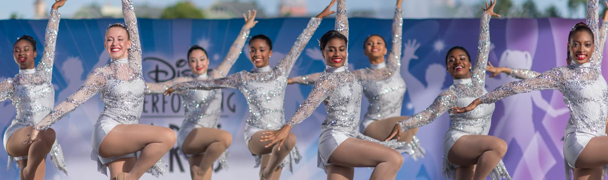 A group of dancers pose onstage