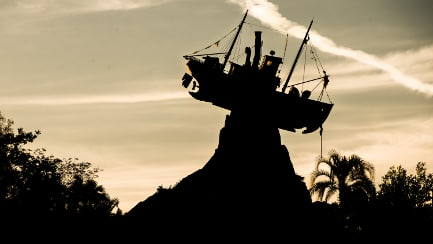 A silhouette of a shipwreck at dusk